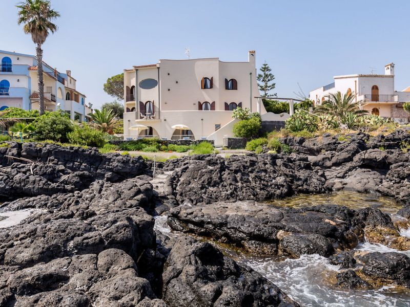 The villa view from the rocky lava beach.